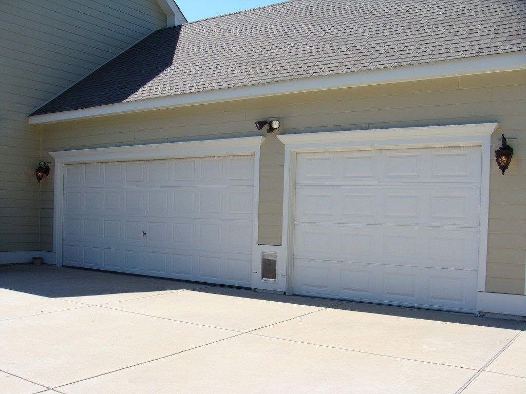 Arctic White Crown Moulding And Trim On Garage Sandstone