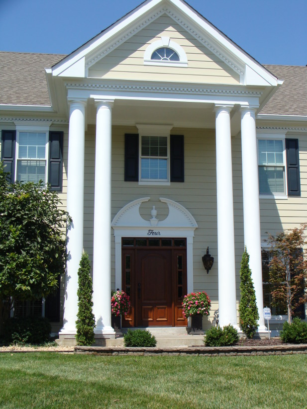 Siding done in Sandstone Beige with Arctic White trim. Door Decor and Dental Moulding. Chesterfield MO